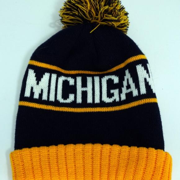ae55578252e1e Michigan Wolverines Spellout Pom Beanie Hat OSFA. M 5b65c34bc61777d96949e700